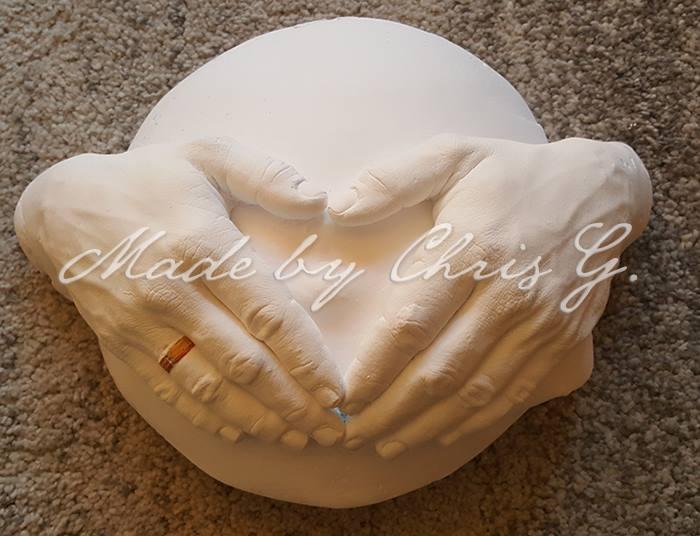 Babybauchabdruck mit Händen