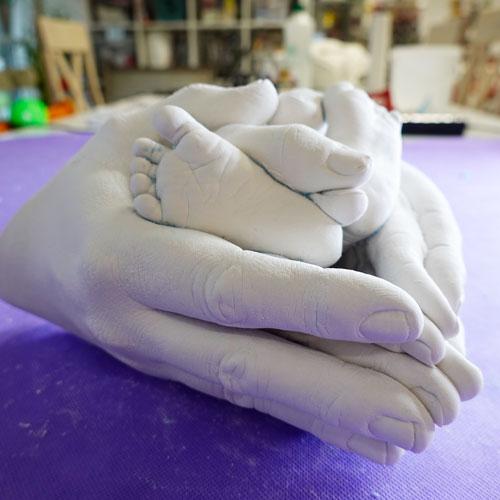Paar Handabdruck mit Baby Fußabdrücken